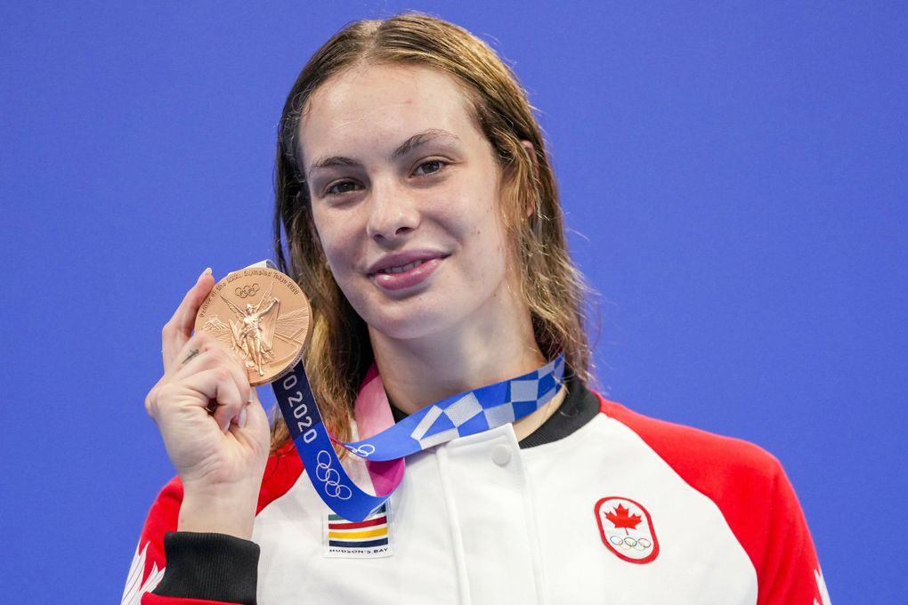 Penny Oleksiak of Canada holds up her bronze medal from the women's 200-meter freestyle final at the 2020 Summer Olympics, Wednesday, July 28, 2021, in Tokyo, Japan. (Matthias Schrader / AP)