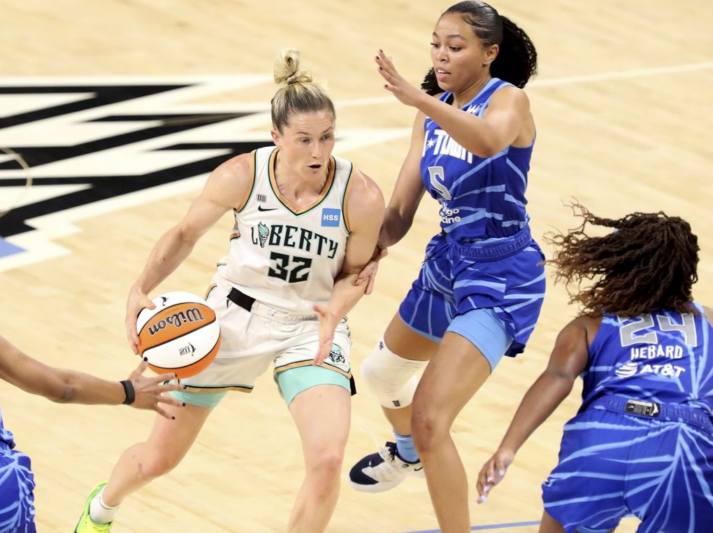 New York Liberty guard Sami Whitcomb (32) tries to protect the ball from Chicago Sky guard Stephanie Watts (5) during a WNBA game, May 23, 2021, in Chicago. (Eileen T. Meslar / AP)