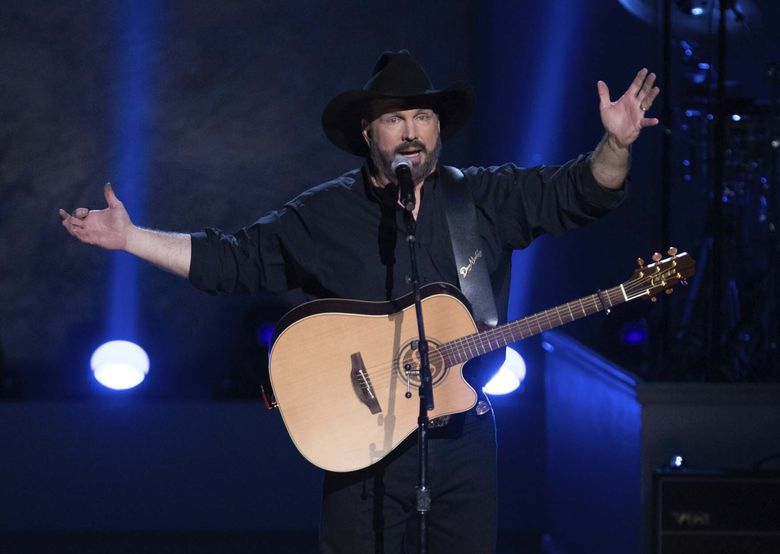 Garth Brooks is canceling his tour dates in five cities, citing a rising number of COVID-19 cases. (Brent N. Clarke / Invision / The Associated Press)