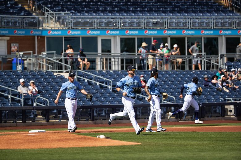 The Mariners take the field with far fewer fans in the stands than were allowed under Covid protocols, March 2, 2021 at Spring Training in Peoria, Ariz. (Dean Rutz / The Seattle Times)