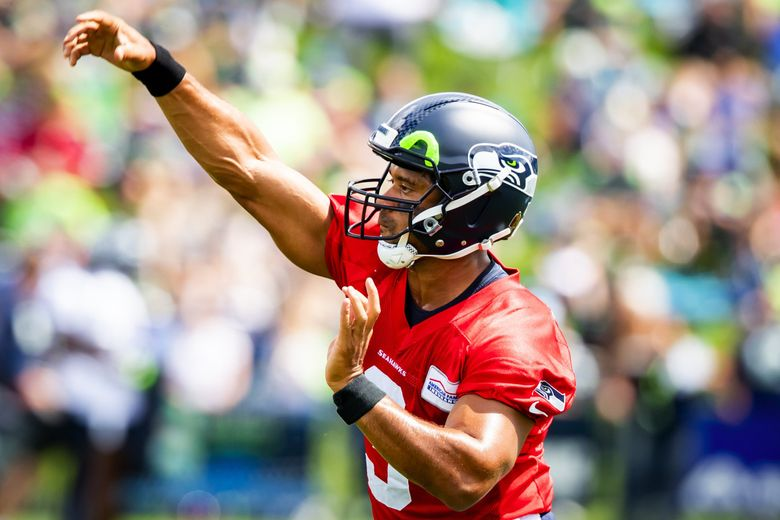 Russell Wilson makes a throw during Seahawks Training Camp at the Virginia Mason Athletic Center in Renton, Aug. 6, 2021. (Bettina Hansen / The Seattle Times)