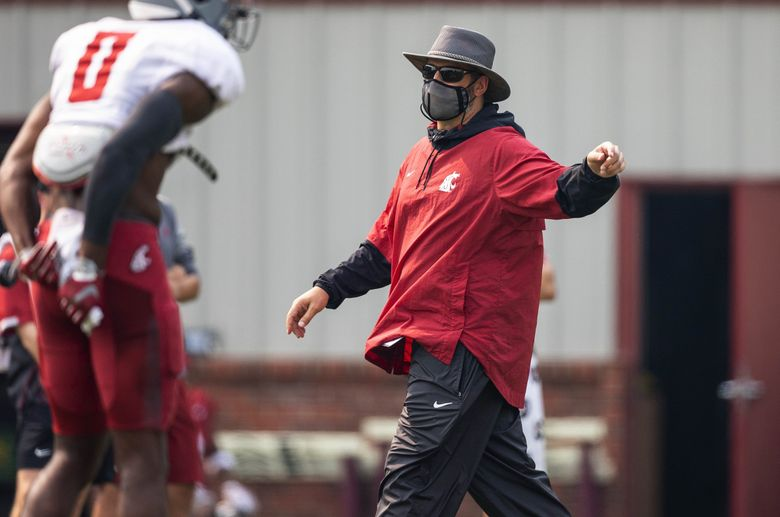 Coach Nick Rolovich instructs the his Cougars during scrimmage at Rogers Field in Pullman, Wash., Thursday, August 12, 2021. (Dean Rutz / The Seattle Times)