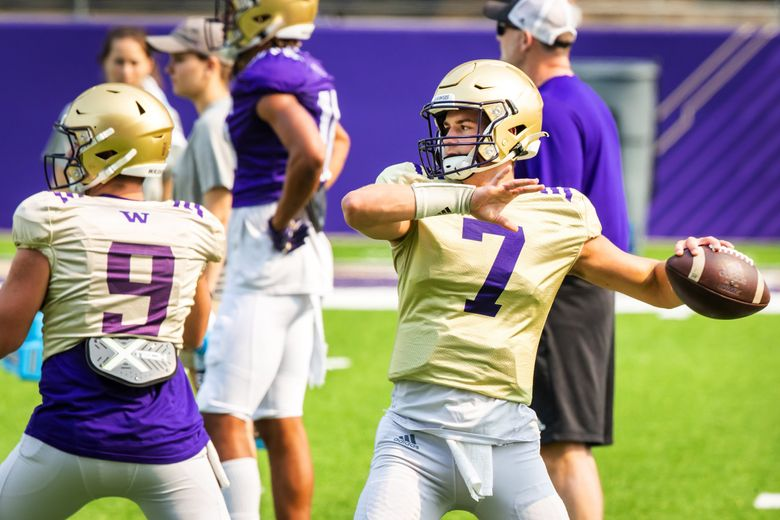 Huskies quarterback Sam Huard winds up to throw as the University of Washington Huskies practice during fall camp at Husky Stadium in Seattle Saturday August 14, 2021. 217935 (Bettina Hansen / The Seattle Times)