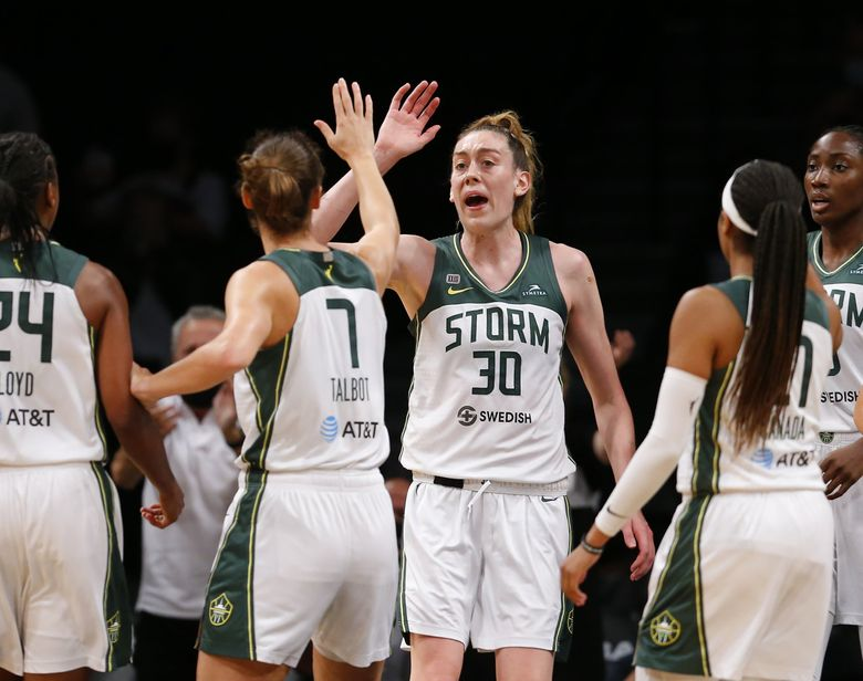 Seattle Storm forwards Stephanie Talbot and Breanna Stewart celebrate after a score against the New York Liberty during the second half. (Noah K. Murray / The Associated Press)