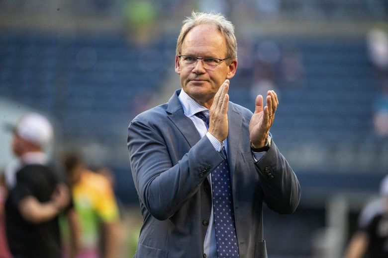 Coach Brian Schmetzer salutes Sounders fans after a game against the Vancouver Whitecaps, June 26, 2021 in Seattle. (Dean Rutz / The Seattle Times)