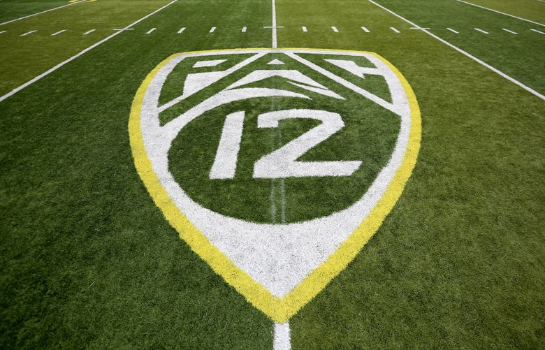 In this Oct. 10, 2015, file photo,  a PAC-12 logo is seen painted on the field before an NCAA college football game between Washington State and Oregon in Eugene, Ore.  (Ryan Kang / AP)