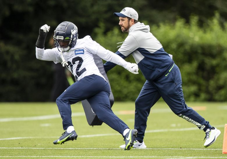 Seattle Seahawks cornerback Tre Brown (22) works on a drill during practice at Virginia Mason Athletic Center on Tuesday, August 17, 2021. (Amanda Snyder / The Seattle Times)