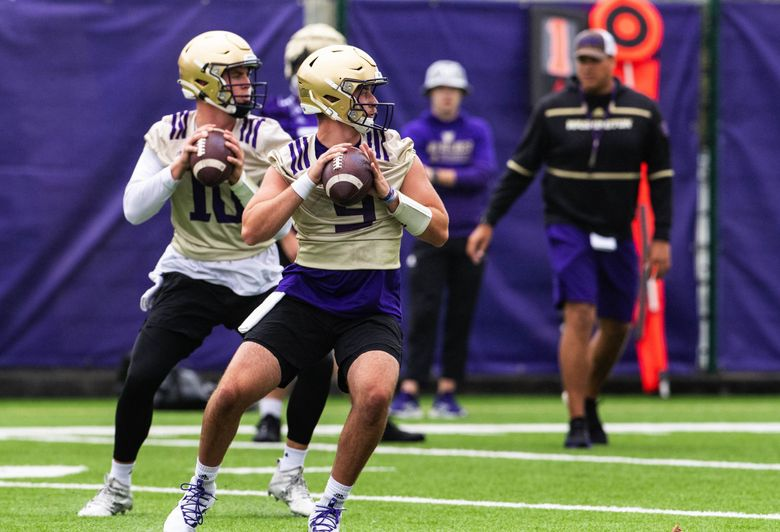 Dylan Morris (9) goes through drills at the Huskies training camp earlier this month. (Dean Rutz / The Seattle Times)