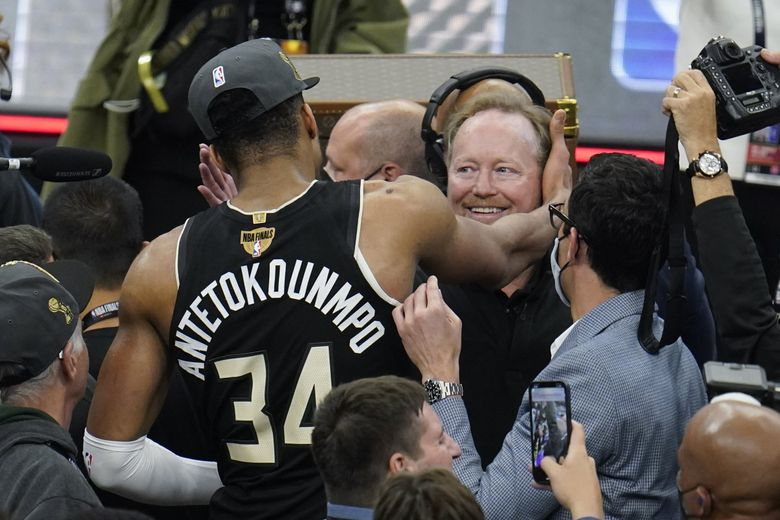 Milwaukee Bucks forward Giannis Antetokounmpo hugs head coach Mike Budenholzer after Game 6 of the NBA Finals in Milwaukee, July 20, 2021. Budenholzer has received a contract extension after guiding the team to its first NBA title in a half century. The Bucks announced Tuesday night, Aug. 24, they had signed Budenholzer to an extension. Details weren't disclosed. (Paul Sancya / AP)