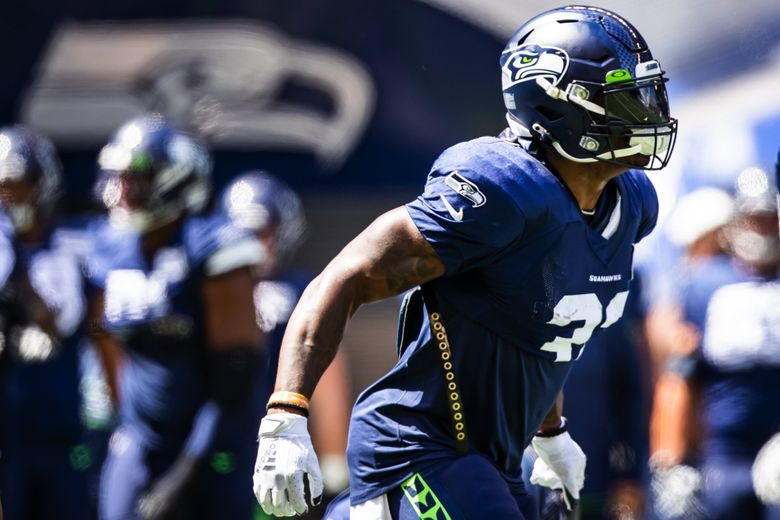 Running back Chris Carson warms up before the Seahawks play a mock game at Lumen Field in Seattle, Aug. 8, 2021. (Bettina Hansen / The Seattle Times)