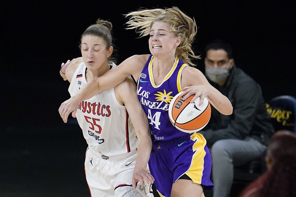 Los Angeles Sparks forward Karlie Samuelson, right, is defended by Washington Mystics forward Theresa Plaisance during a game, June 24, 2021, in Los Angeles. (Marcio Jose Sanchez / AP)