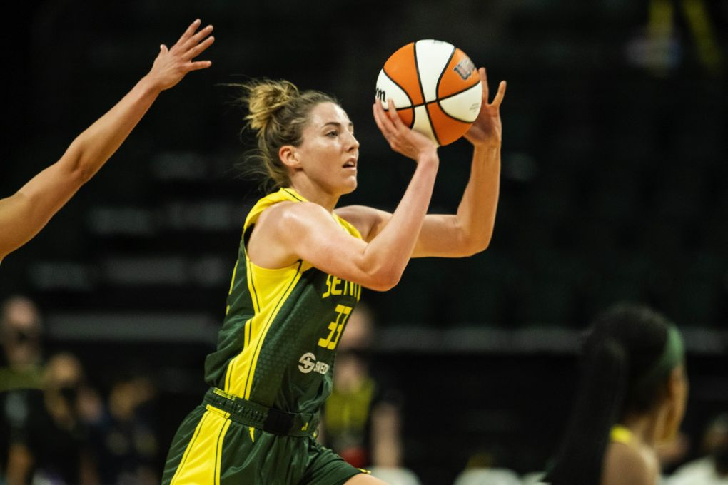 Katie Lou Samuelson hits a shot with no time left, and from near midcourt, to end the third quarter against Las Vegas, May 18, 2021, in Everett. (Dean Rutz / The Seattle Times)