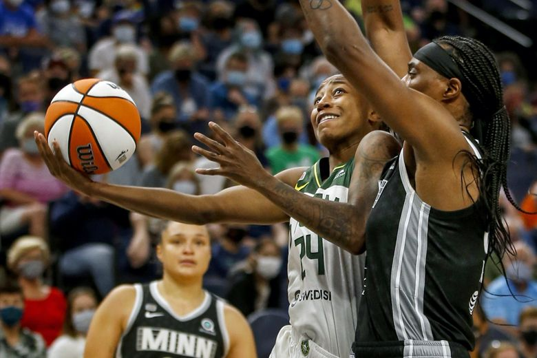 Seattle Storm guard Jewell Loyd (24) drives to the basket as Minnesota Lynx center Sylvia Fowles (34) defends her in the fourth quarter of a WNBA basketball game on Tuesday in Minneapolis. (Bruce Kluckhohn / The Associated Press)