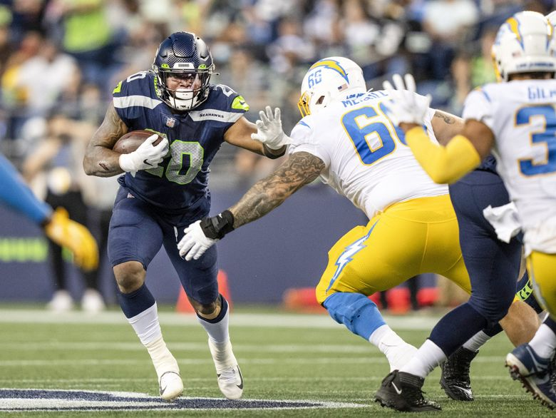 Seattle Seahawks running back Rashaad Penny rushes the ball in a preseason game against the Los Angeles Chargers, Aug. 28, 2021, in Seattle. (Stephen Brashear / AP)