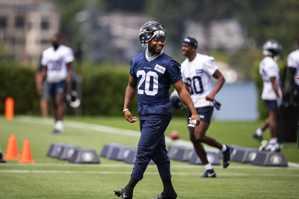 Rashaad Penny heads out for practice, July 28, 2021 at the VMAC in Renton. (Dean Rutz / The Seattle Times)