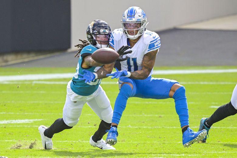 Jacksonville Jaguars cornerback Sidney Jones breaks up a pass intended for Detroit Lions wide receiver Marvin Jones during a game last season in Jacksonville, Fla. (Phelan M. Ebenhack / AP)