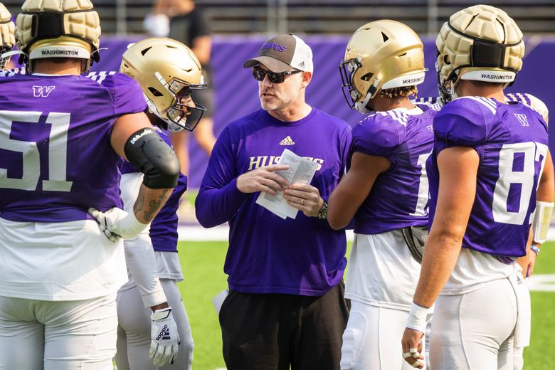 Offensive coordinator and quarterbacks coach John Donovan works with the offense as the University of Washington Huskies practice during fall camp in Seattle, Aug. 14, 2021. (Bettina Hansen / The Seattle Times)