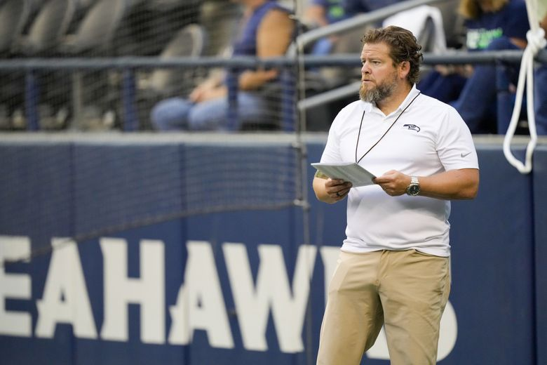 Seattle Seahawks general manager John Schneider stands on the field during warmups before a preseason game against the Denver Broncos, Aug. 21, 2021, in Seattle. (Stephen Brashear / AP)