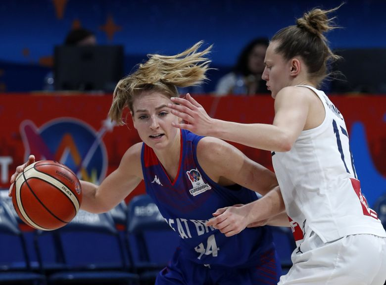Karlie Samuelson, playing for Great Britain, drives to the basket as France's Marine Johannes tries to block her during the Women's 2019 Eurobasket European Basketball Championship in Belgrade, Serbia, Saturday, July 6, 2019.  (Darko Vojinovic / AP)