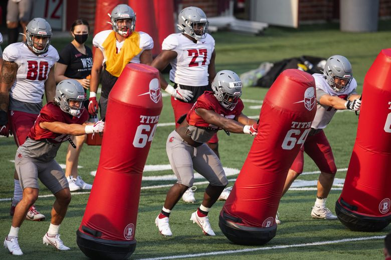 The Washington State Cougars practice, Aug. 12, 2021 at Rogers Field in Pullman. (Dean Rutz / The Seattle Times)