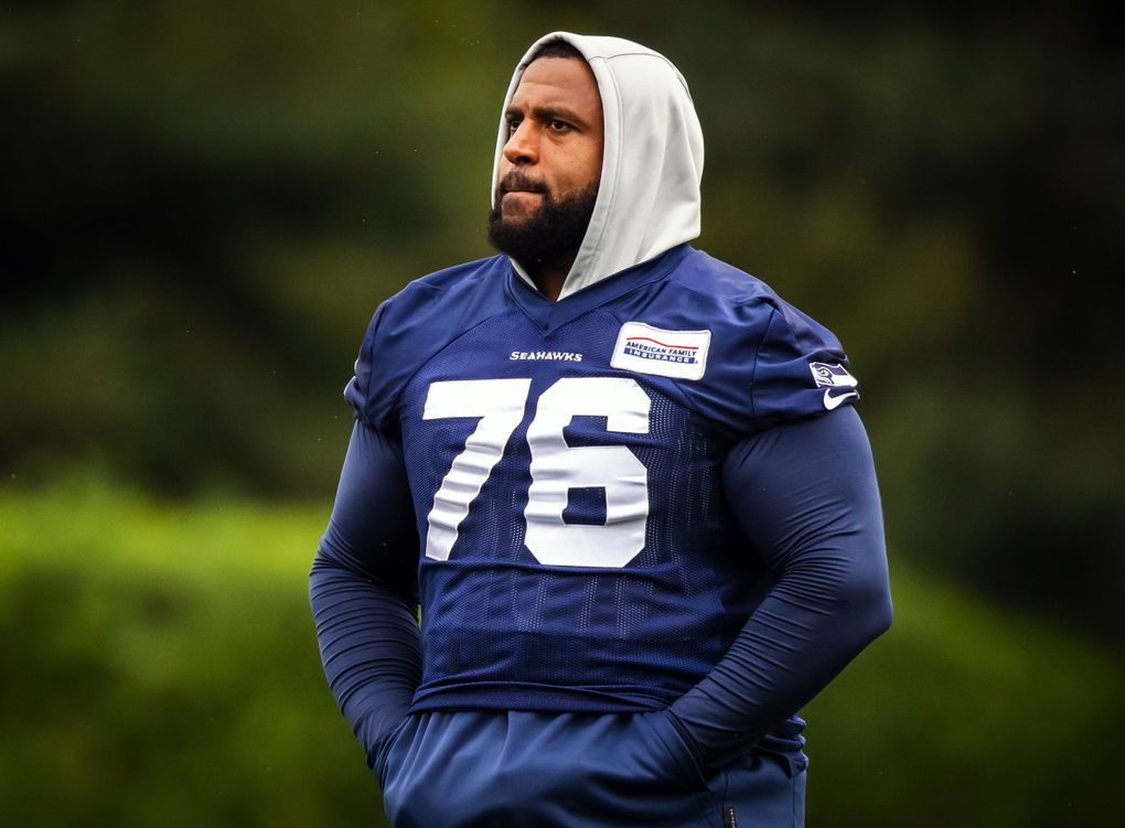 Seahawks offensive tackle Duane Brown walks off the field after sitting out another training-camp practice while awaiting a new contract late last month at the VMAC in Renton. (Bettina Hansen / The Seattle Times)