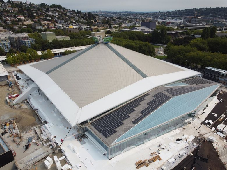 Solar panels are now seen attached to the Alaska Airlines Atrium, as Climate Pledge Arena speeds toward completion, Aug. 1, 2021 in Seattle. Construction is in a race against time for a planned mid-October inaugural regular season NHL Kraken game. (Ken Lambert / The Seattle Times)
