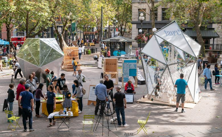 Overview shot of the 2018 Seattle Design Festival Block Party in Occidental Square. Over the course of a weekend, more than 10,000 visitors gathered to experience this two-day street fair celebrating design. This year's Seattle Design Festival will take place Aug. 21-22 at Lake Union Park. (Trevor Dykstra / Courtesy of AIA)