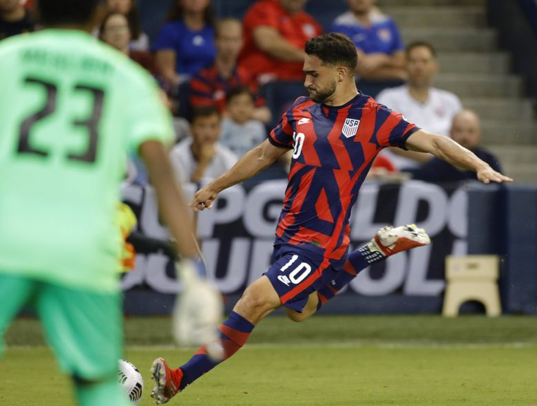 United States midfielder Cristian Roldan (10) attempt to score during a CONCACAF Gold Cup soccer match against Martinique in Kansas City, Kan., Thursday, July 15, 2021. (Colin E. Braley / The Associated Press)