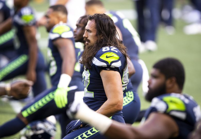 Tight end Luke Willson stretches in warmups before a game against the New England Patriots  in Seattle, Sept. 20, 2020. (Bettina Hansen / The Seattle Times)