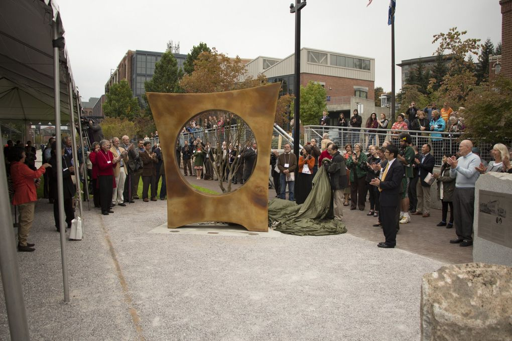 """Gerard Tsutakawa's """"Maru,"""" which memorializes Tacoma's Japanese Language School or Nihongo Gakko, is unveiled in 2014. Although the school  building no longer exists, and the site is owned by University of Washington Tacoma, Tsutakawa worked closely with its past students to design the sculpture. (Courtesy of Gerard Tsutakawa)"""