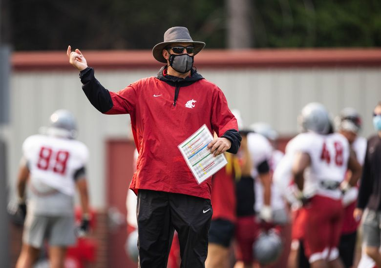 Coach Nick Rolovich watches his Cougars scrimmage earlier this month. (Dean Rutz / The Seattle Times)