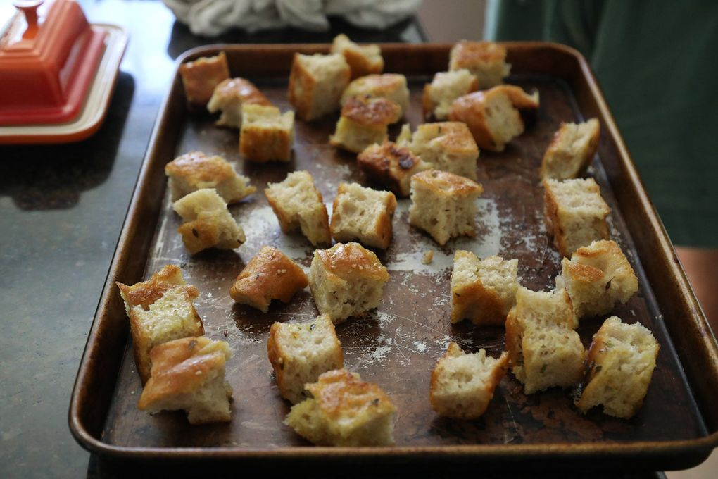 """Brett Bankson, a Seattle-area neuroscience student is competing on the TV show """"Top Chef Amateurs."""" He sliced up these bread croutons for a salad, heated on a pan for a short time. (Greg Gilbert / The Seattle Times)"""