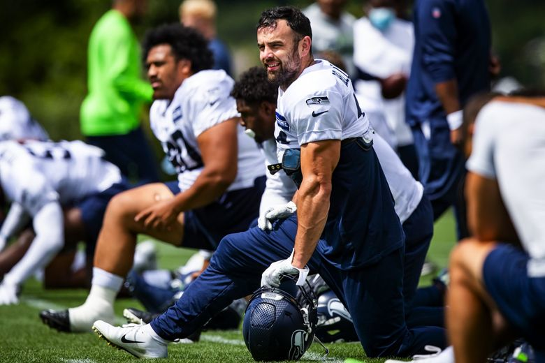 Seahawks fullback Nick Bellore, working out as a linebacker for depth, stretches during Seahawks Training Camp at the Virginia Mason Athletic Center in Renton Saturday, August 7, 2021. (Bettina Hansen / The Seattle Times)