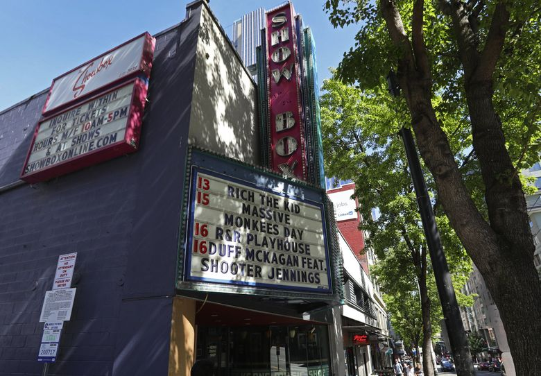 On Thursday, concert industry power AEG, which operates the Showbox theater, seen here in 2019, announced it will require fans to show proof of vaccination or a negative COVID-19 test taken within 72 hours before the day of a show in all its venues by Oct. 1. (Ken Lambert / The Seattle Times)
