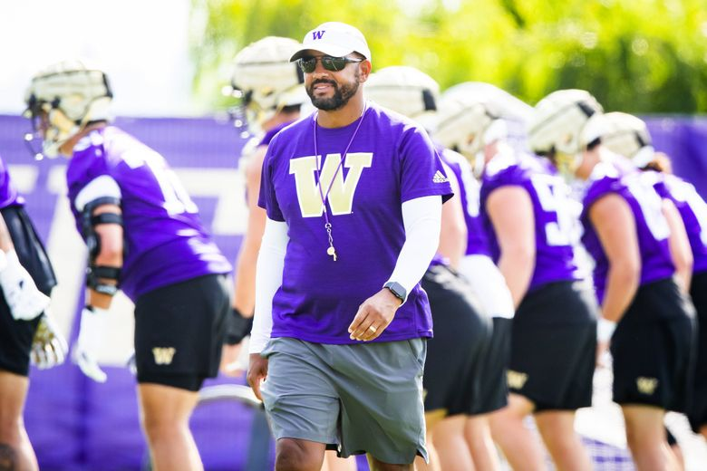 Head coach Jimmy Lake watches over practice during fall camp at the University of Washington's Husky Stadium in Seattle Sunday August 15. (Bettina Hansen / The Seattle Times)