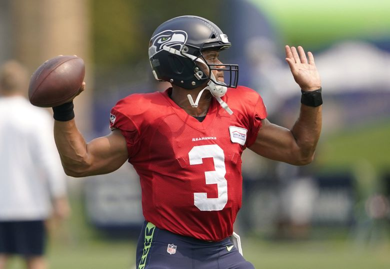 Seattle Seahawks quarterback Russell Wilson throws a pass during NFL training camp Tuesday, Aug. 3, 2021, in Renton, Wash. (Ted S. Warren / The Associated Press)