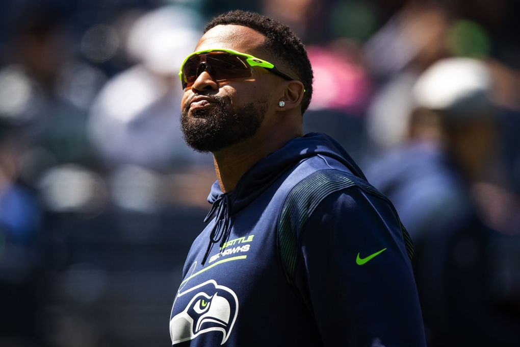 """Seahawks safety Jamal Adams watches the team's mock game Sunday at Lumen Field as he continues his """"hold-in"""" during contract negotiations. Bettina Hansen / The Seattle Times)"""
