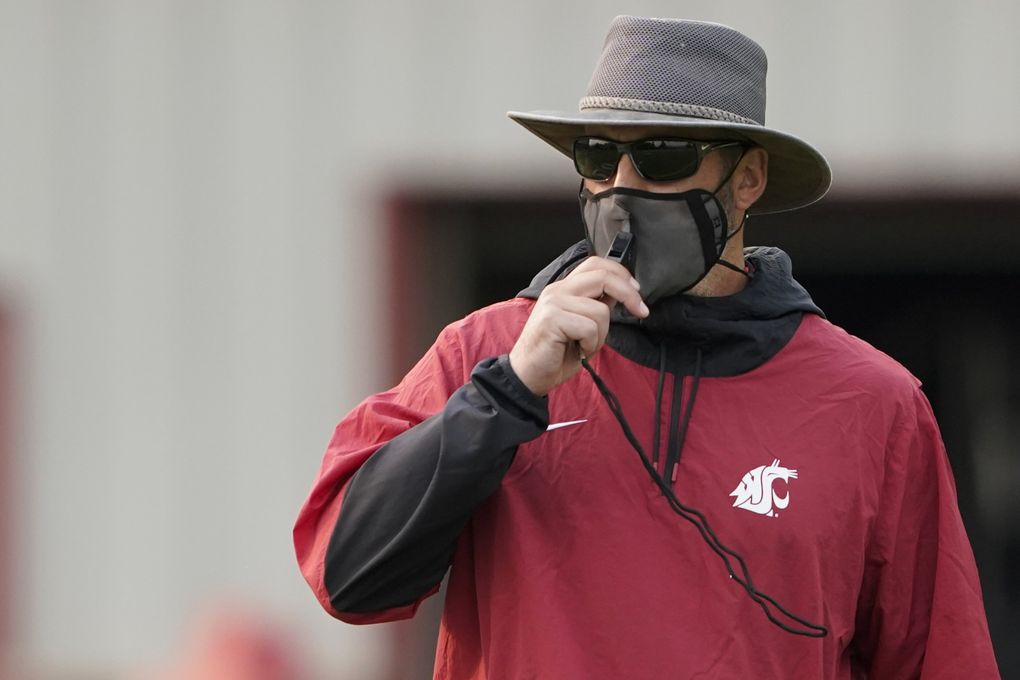 Washington State football coach Nick Rolovich has decided against getting the COVID-19 vaccine. (Ted S. Warren / The Associated Press)