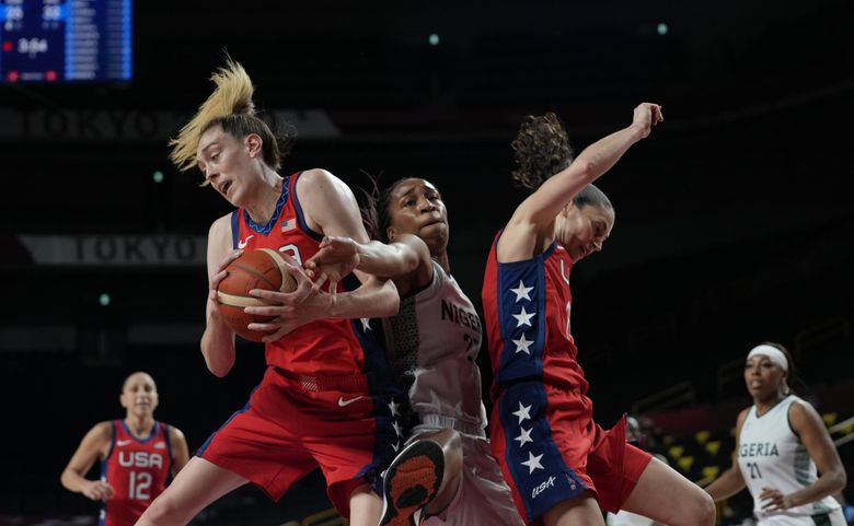 United States' Breanna Stewart (10), left, Nigeria's Oderah Chidom (22), center, and United States' Sue Bird (6) battle for a rebound during women's basketball preliminary round game at the 2020 Summer Olympics, Tuesday, July 27, 2021, in Saitama, Japan. (Eric Gay / The Associated Press)