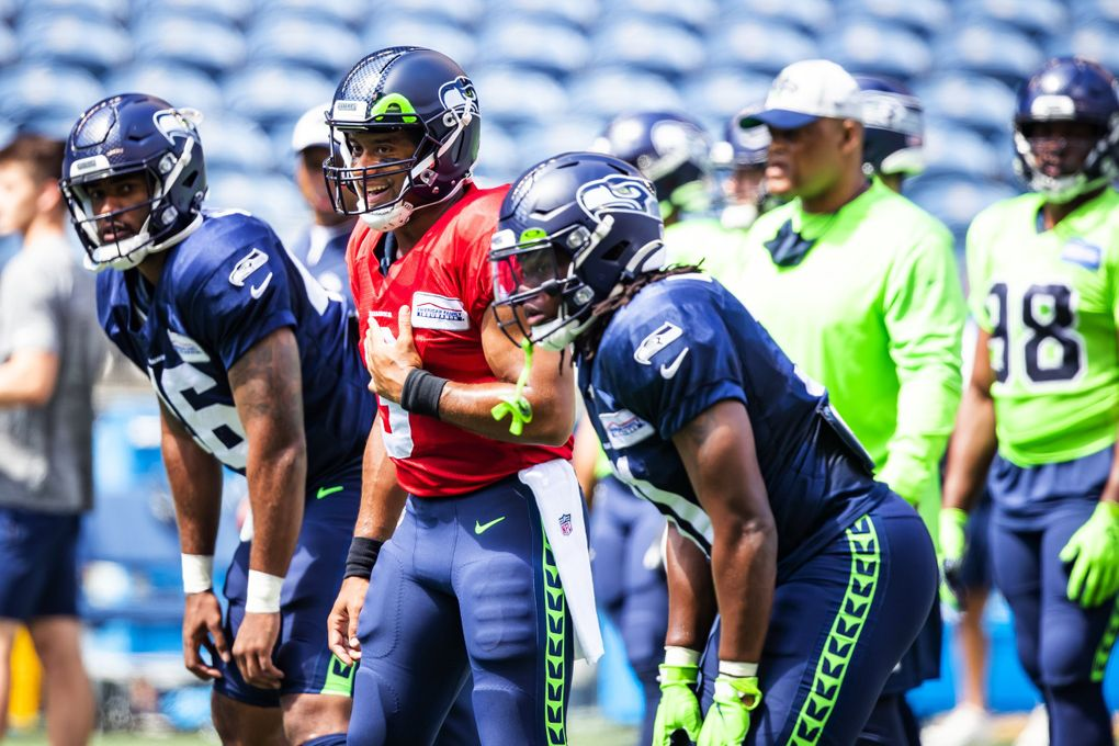 Seahawks quarterback Russell Wilson is all smiles during warmups before the Seahawks play a mock game as part of training camp at Lumen Field in Seattle Sunday, August 8, 2021.  (Bettina Hansen / The Seattle Times)