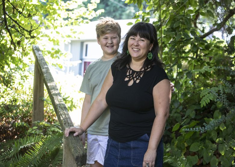 """Anne Liu Kellor is the author of the forthcoming debut memoir """"Heart Radical: A Search for Language, Love, and Belonging."""" She is photographed with her 11-year-old son (unnamed by request) at their home in North Seattle Tuesday, Aug. 24, 2021. (Steve Ringman / The Seattle Times)"""