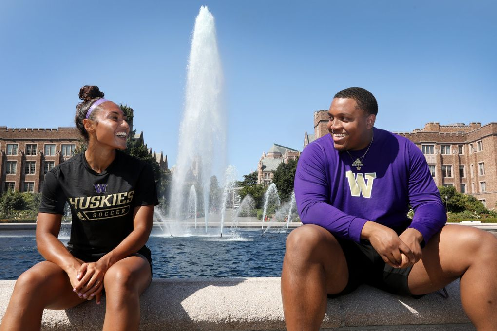 UW soccer player MaKayla Woods and UW Track and Field discus thrower Elijah Mason, seen on campus at the Drumheller Fountain, are the co-presidents of UW's Black Student Athlete Alliance. (Ken Lambert / The Seattle Times)