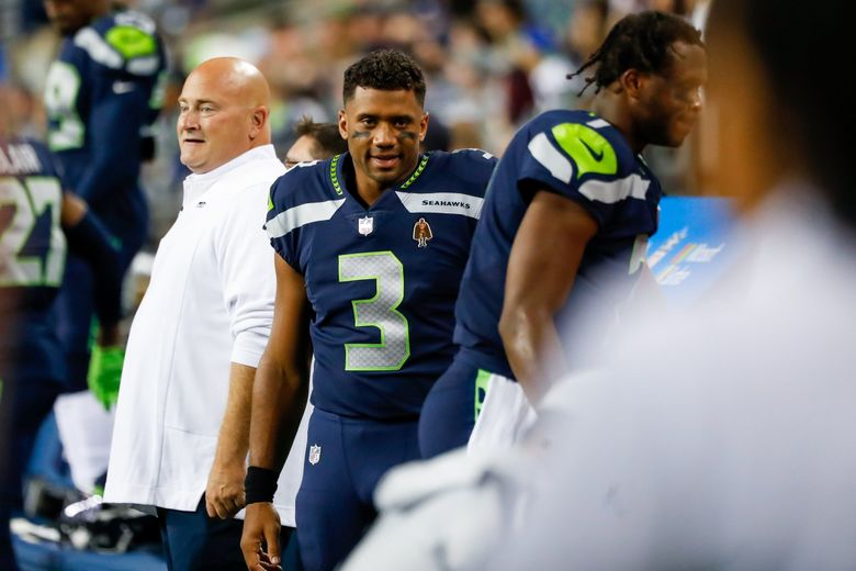 Seahawks quarterback Russell Wilson stalks the sidelines during the second quarter against the Chargers on Saturday, another preseason game he didn't play in. (Jennifer Buchanan / The Seattle Times)