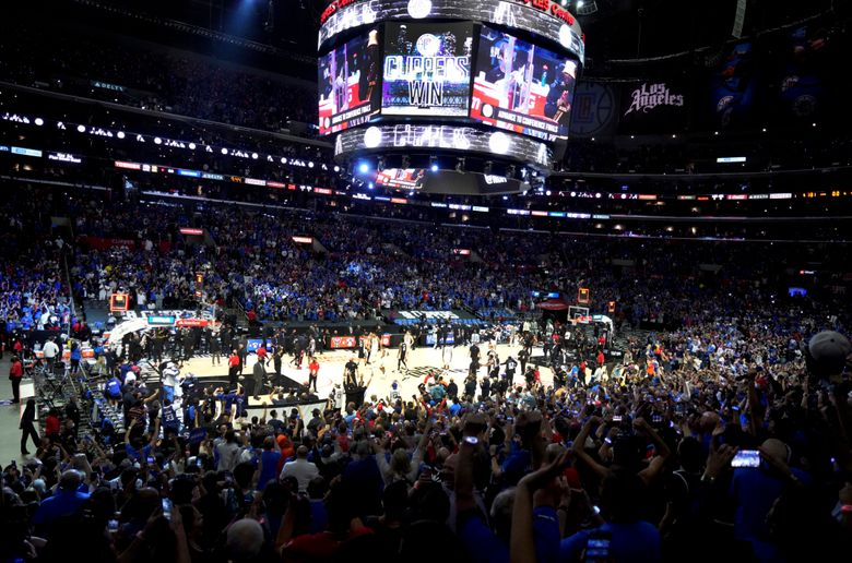 FILE – In this June 18, 2021, file photo, Los Angeles Clippers fans cheer in the final moments of the Clippers' 131-119 win over the Utah Jazz in Game 6 of the second-round of the Western Conference the NBA basketball playoffs. California will tighten its rules for indoor events starting Sept. 20, 2021, requiring either proof of vaccination or a negative coronavirus test for gatherings of 1,000 people or more as new virus cases continue to climb because of the delta variant. (Keith Birmingham/The Orange County Register via AP, File)