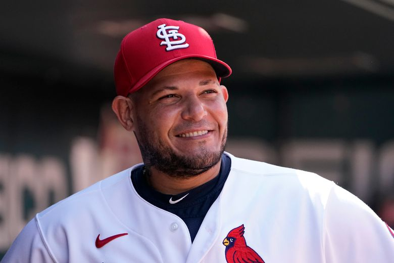 St. Louis Cardinals catcher Yadier Molina smiles in the dugout during the ninth inning of a baseball game against the Detroit Tigers Wednesday, Aug. 25, 2021, in St. Louis. (AP Photo/Jeff Roberson)