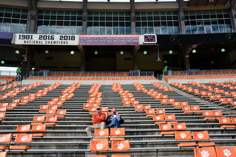 FILE – In this Oct. 31, 2020, file photo, Clemson fans arrive early before an NCAA college football game against Boston College in Clemson, S.C. Clemson, which has played in four of the past six national title games, estimated a university-wide loss of between $70 million and $135 million due to COVID-19 in the last fiscal year. About a third came from lost athletics revenue, and the vast majority of that came from reduced football ticket sales to ensure proper social distancing. ( Josh Morgan/Pool Photo via AP, File)