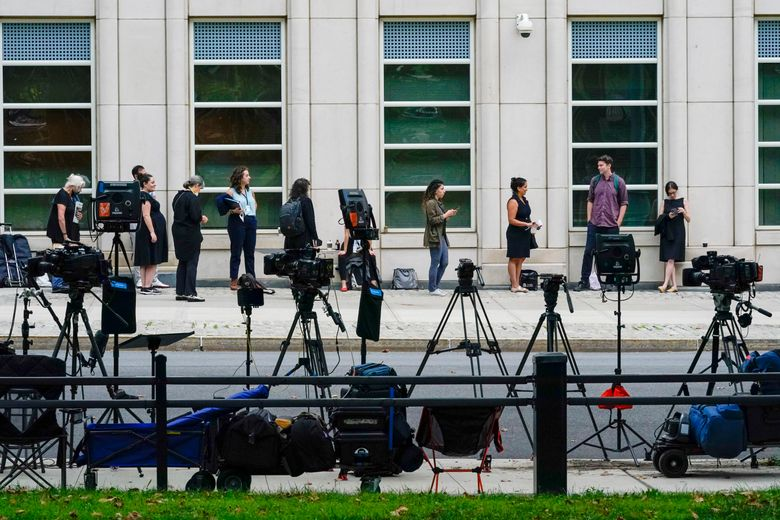 Television crew equipment is set up across the street as reporters and spectators line up outside Brooklyn Federal court for opening statements in R&B star R. Kelly's long-anticipated federal trial arising from years of allegations that he sexually abused women and girls, Wednesday, Aug. 18, 2021, in New York. (AP Photo/Mary Altaffer)