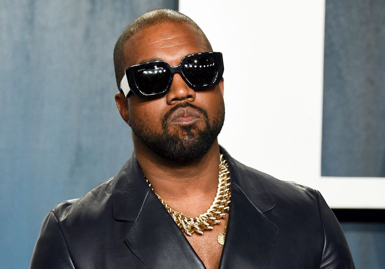 FILE – Kanye West arrives at the Vanity Fair Oscar Party in Beverly Hills, Calif., on Feb. 9, 2020. Kanye just wants to be Ye. Kanye West filed court documents Tuesday, Aug. 24, 2021, to legally change his name.  (Photo by Evan Agostini/Invision/AP, File)