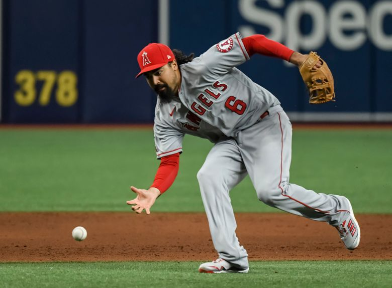 FILE – In this June 25, 2021, file photo, Los Angeles Angels third baseman Anthony Rendon reaches for a ball that went for an infield base hit by Tampa Bay Rays ' Kevin Kiermaier during the sixth inning of a baseball game in St. Petersburg, Fla. Rendon will have season-ending hip surgery, finishing off an injury-plagued second season in Southern California. The club made the announcement before Wednesday's game at Texas.(AP Photo/Steve Nesius, File)