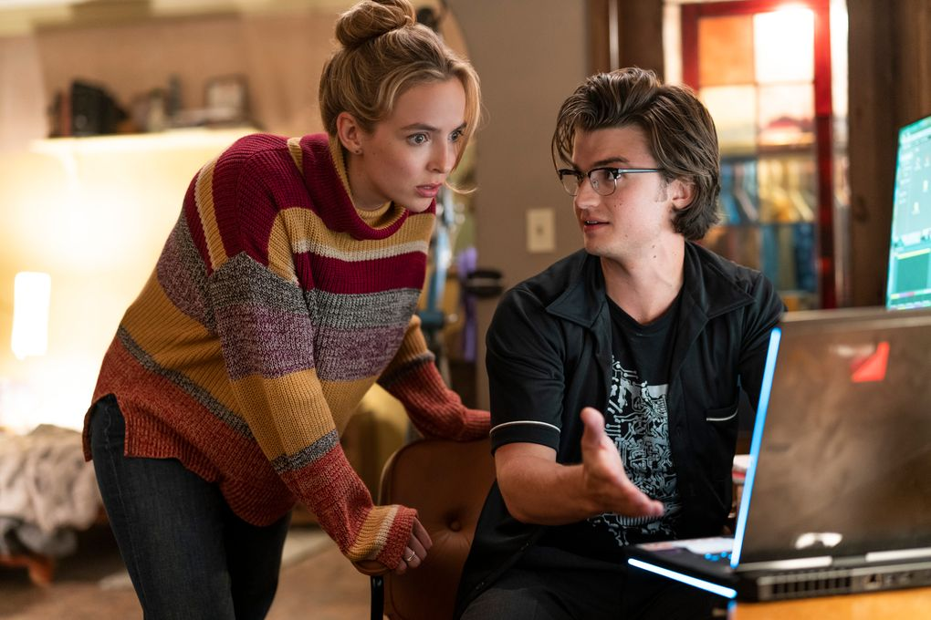 """Jodie Comer, left, and  Joe Keery play young programmers Millie and Keys in """"Free Guy."""" (Alan Markfield / 20th Century Studios via The Associated Press)"""